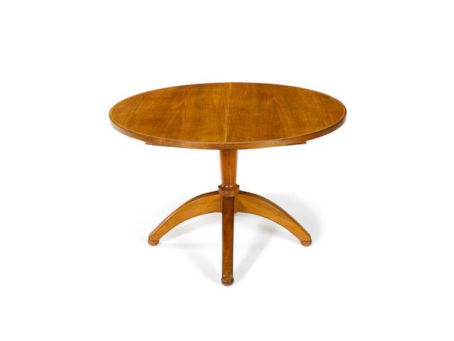 A Barnsley walnut extending dining table