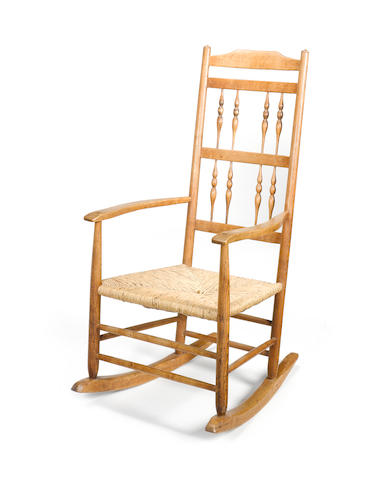 An Arts and Crafts rocking chair designed by Ernest Gimson