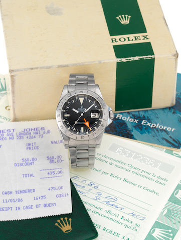 Rolex. A fine stainless steel centre seconds automatic wristwatch with 24-hour bezel and orange hand together with the original punched Guarantee papers, fitted Rolex box and bill of saleExplorer II, Ref:1655, Case No.6312361, Sold 11th January 1986