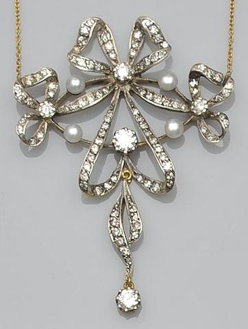 A Victorian style pearl and diamond pendant necklace