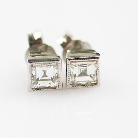 A pair of square diamond set earstuds