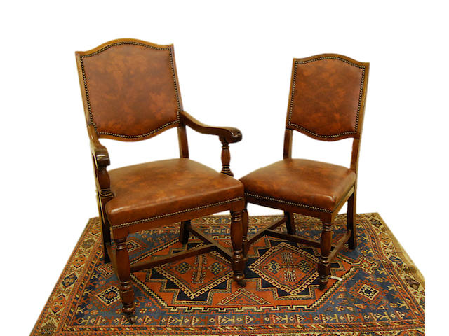 A set of twelve walnut dining chairs, early 20th Century