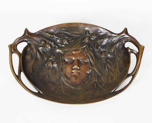 A continental Art Nouveau patinated bronze dish
