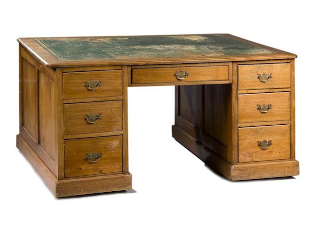 An early 20th century oak kneehole partners desk