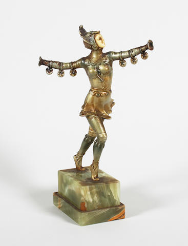 An Art Deco style painted spelter and ivorine mounted figure