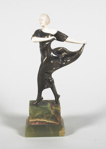 An Art Deco cast bronze and carved ivory mounted figure