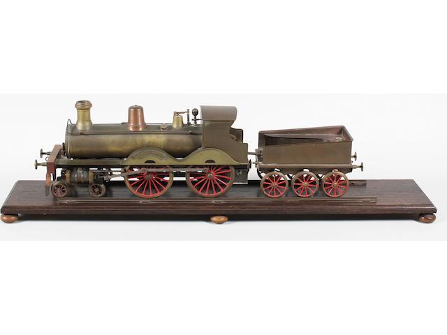 Brass model of a loco & tender on oak plinth
