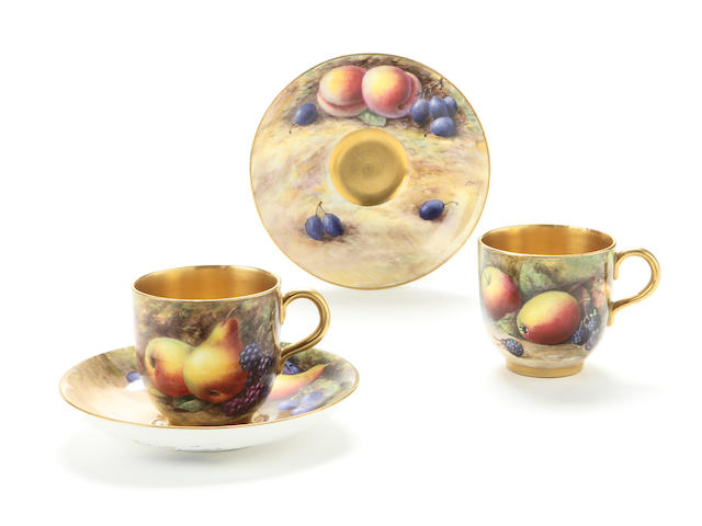 A Royal Worcester fruit decorated part coffee set Date code for 1925