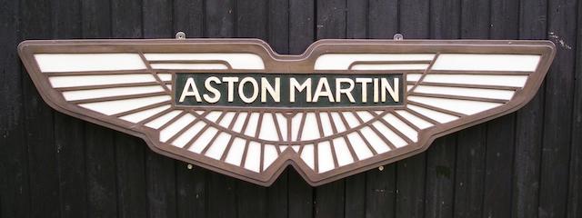 A cold-cast bronze composite Aston Martin badge,