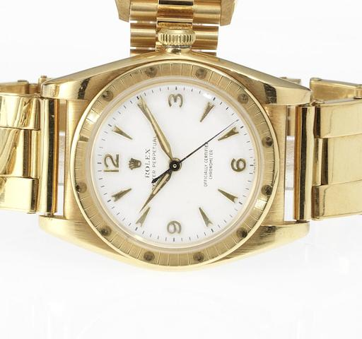 Rolex. An 18ct gold automatic centre seconds bubble back bracelet watch Oyster, Ref:4984, 1949