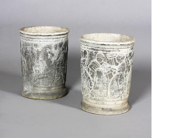 An unusual pair of weathered lead terrace vases in the manner of Sir Edwin Lutyens, circa 1920