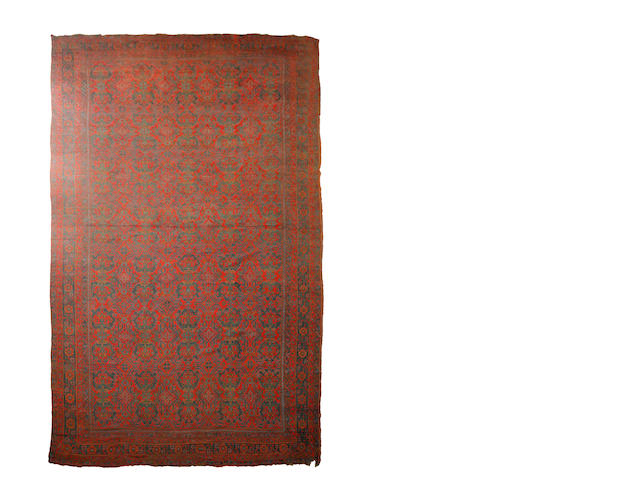 A large Ushak carpet 518cm x 914cm