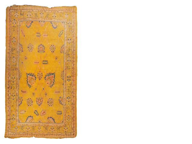 An Ushak carpet 377cm x 509cm