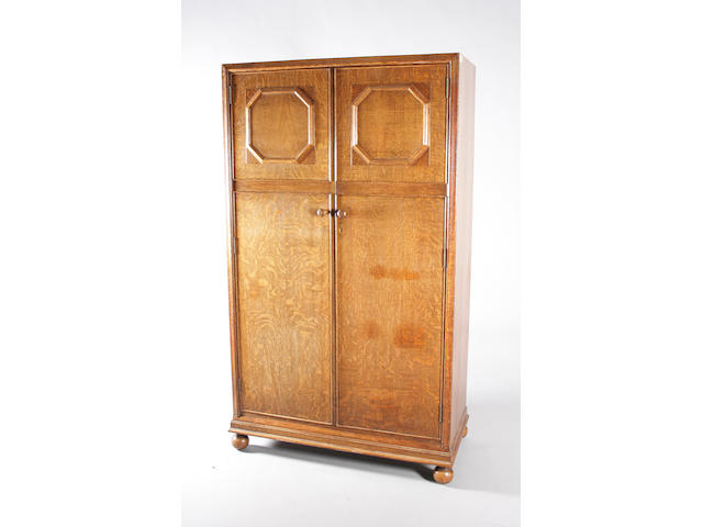 A Heal's stained oak compactum wardrobe, circa 1920