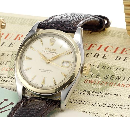 Rolex. A fine and rare stainless steel and gold, automatic centre seconds calendar wristwatch together with original chronometer & service papers Datejust, Ref:6104, Made in 1953