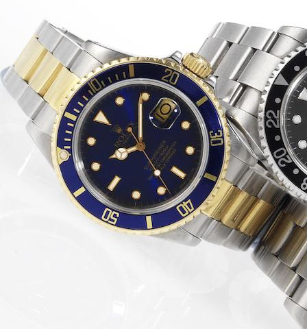 Rolex. A fine stainless steel and gold automatic centre seconds calendar bracelet watch Submariner, Date, Ref:16803, Made in 1987