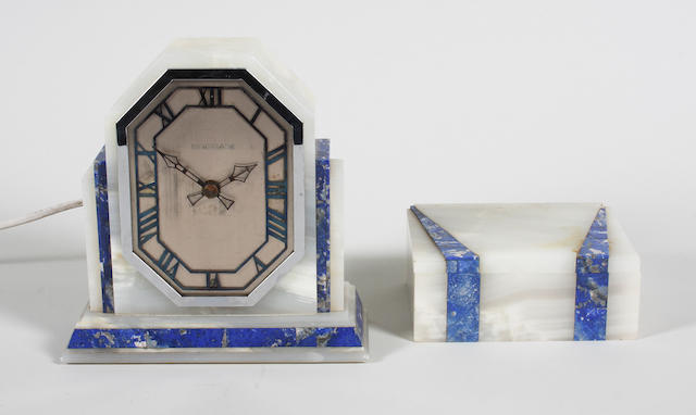 An Art Deco onyx and blue marble cased mantel timepiece and a matching cigarette box