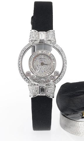 Chopard. A fine lady's 18ct white gold diamond set cocktail watch Happy Diamonds, 1990's