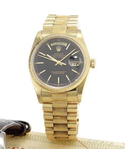 Rolex. A fine 18ct gold automatic centre seconds calendar bracelet watch together with fitted presentation box & papersDay-Date, Made in 1977, Sold December 9th 1977