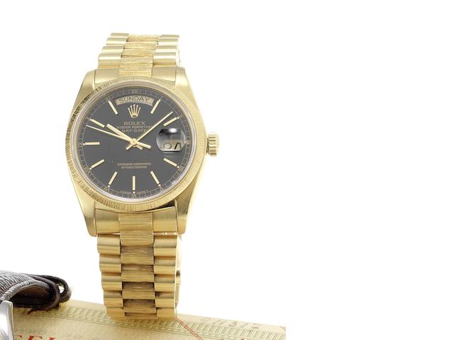 Rolex. A fine 18ct gold automatic centre seconds calendar bracelet watch together with fitted presentation box & papers Day-Date, Made in 1977, Sold December 9th 1977