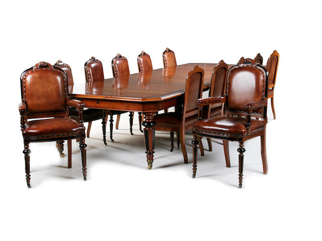 An impressive late Victorian walnut dining room suite retailed by Warings