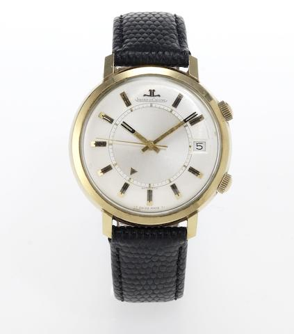 Jaeger LeCoultre. A 14ct gold automatic centre seconds calendar alarm wristwatchMemovox, 1960's
