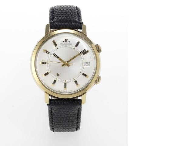 Jaeger LeCoultre. A 14ct gold automatic centre seconds calendar alarm wristwatch Memovox, 1960's