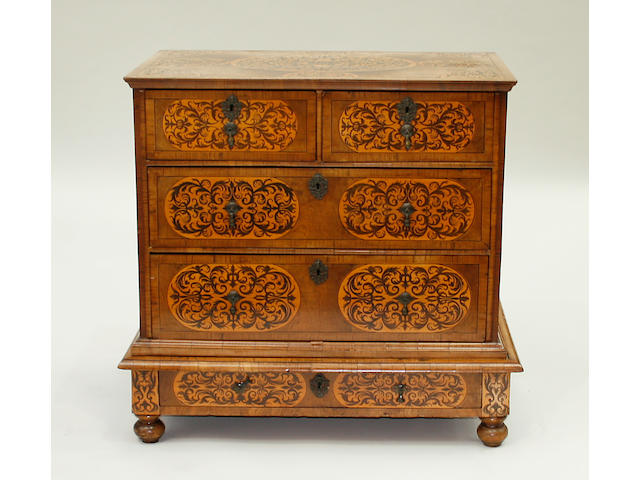 A late 17th century and later walnut and arabesque marquetry chest on stand