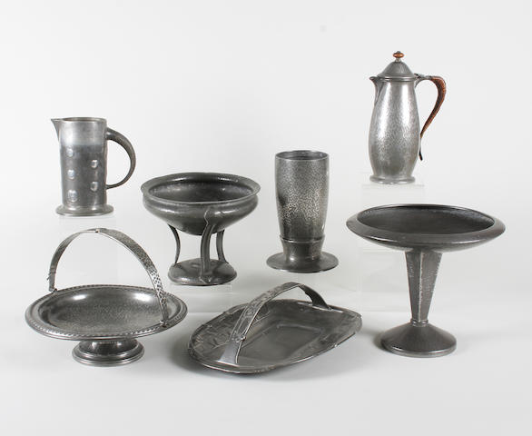 A group of seven various pieces of art pewter including a Liberty & Co. 'Tudric' patinated pewter cake basket designed by Archibald Knox