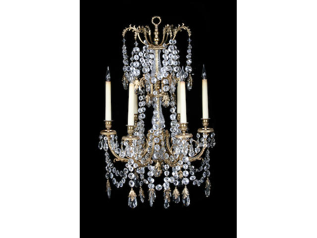 A pair of gilt metal and cut glass six light chandeliers