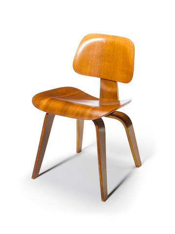 Charles and Ray Eames for Evans Products, a 'DCW', designed 1945 in walnut faced moulded plywood