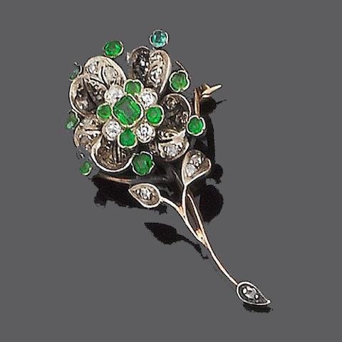A demantoid garnet and diamond brooch,