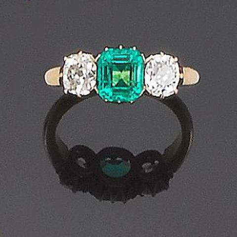 A late 19th century emerald and diamond three-stone ring