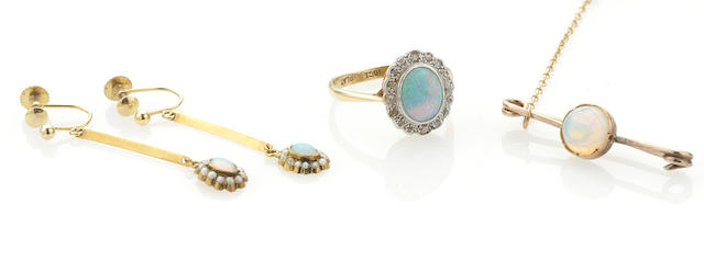 An opal ring, earring and brooch suite