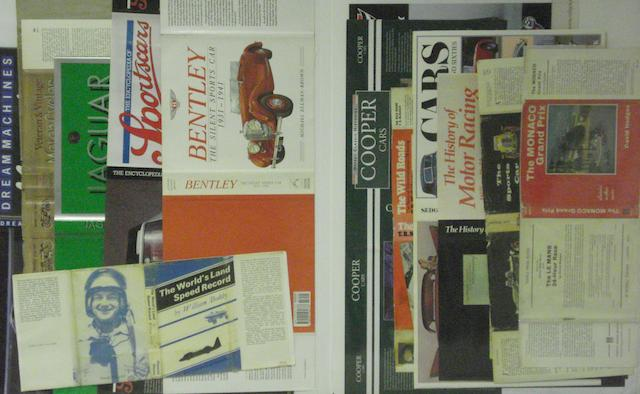 Assorted dust-jackets for motoring books,