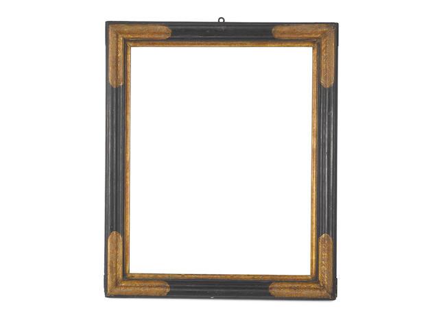 An Italian 17th Century parcel gilt and black painted frame