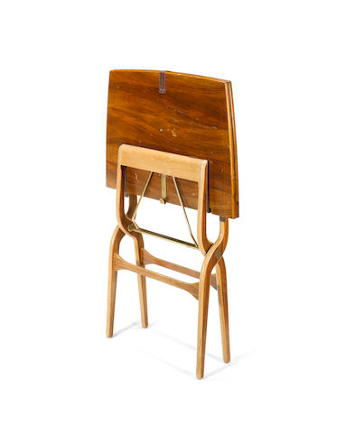 Neil Morris for H. Morris and Co, a 'Cumbrae' folding table and bookcase, designed circa 1949 the table in walnut and beech moulded plywood, with brass and leather detail, the case in walnut and mahogany with glass doors