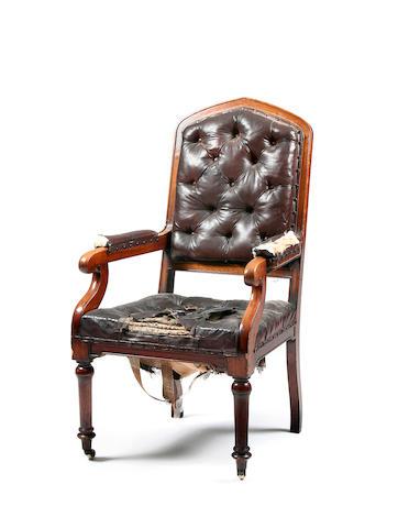 A Victorian oak library open armchair, circa 1860