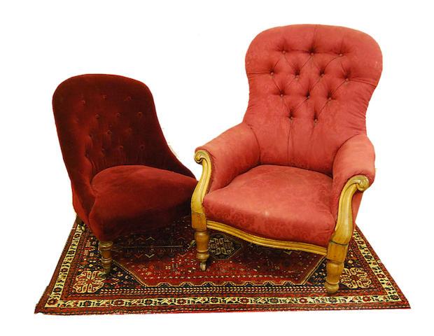 A Victorian mahogany-framed spoonback armchair