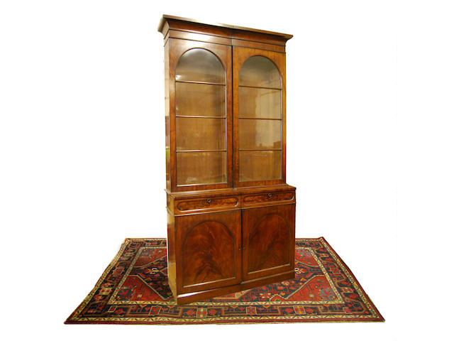 A reduced mahogany library bookcase, early 19th Century