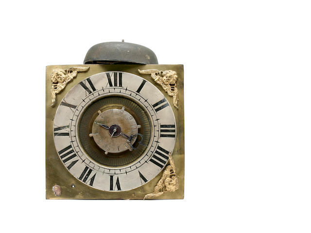 An early 18th Century brass hook-and-spike wall timepiece with alarmwork Anonymous, possibly of Oxfordshire Quaker manufacture in the manner of the Gilkes family sold with weight and pendulum