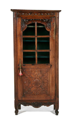 A French late 19th/early 20th century carved oak and fruitwood display cabinet