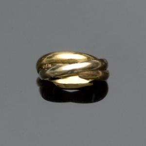 A trilogy ring, by Must de Cartier