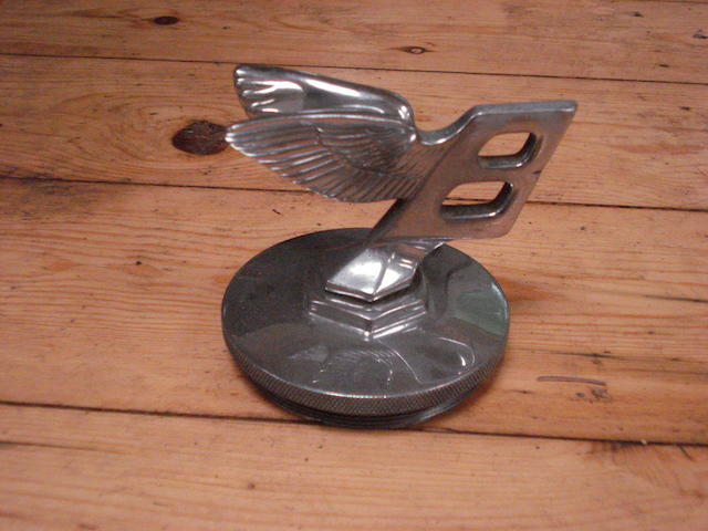 A Bentley forward leaning Winged 'B' mascot,