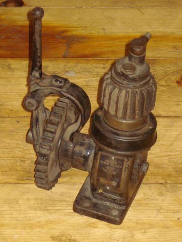 A Stewart Tire pump, American, patented June 6 1914,