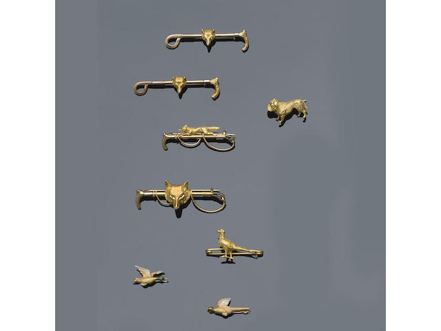 A collection of animal stickpins and bar brooches