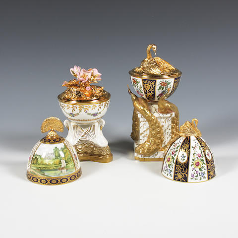 Two Royal Worcester limited edition silver gilt and porcelain models 'The Swan Egg' and 'The Peacock Egg' Dated 1984 and 1985.