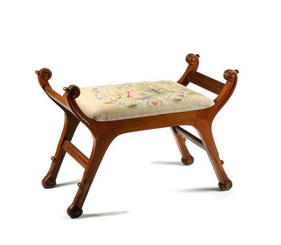 A mahogany 'X'-framed dressing stool