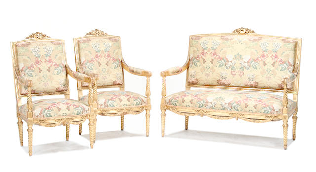 An early 20th century carved giltwood salon suite of Louis XVI style