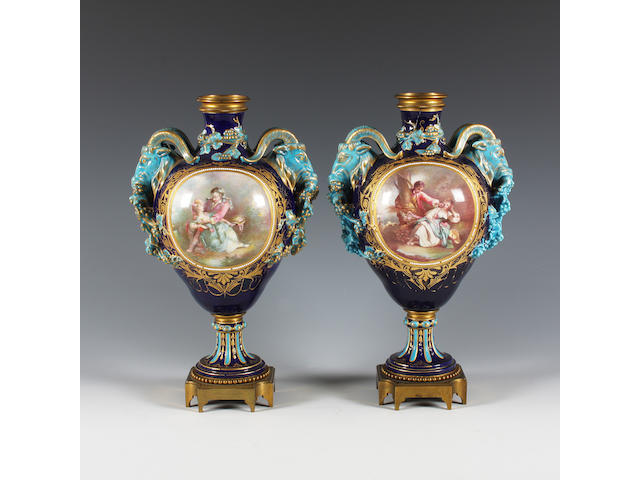 A pair of Sèvres style gilt metal mounted vases Late 19th Century.